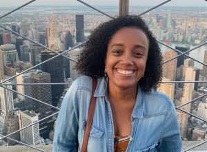 Jessica Poitevien, a Haitian-American writer (smiling black woman against a cityscape – probably New York)
